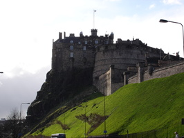 Edinburgh castle and green grass.