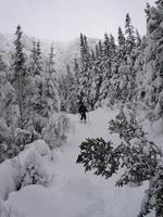 Me skiing down Sherburne Trail