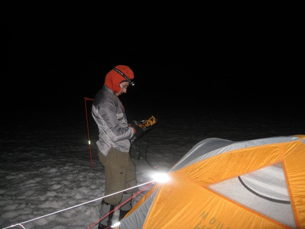 3198_pavel_stowing_crampons_at_tent